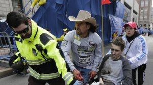 A terribly injured Jeff Bauman being taken for medical help.