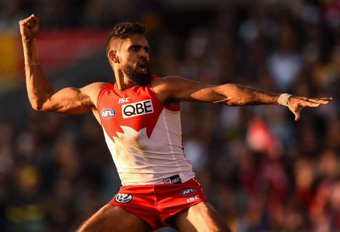 PERTH, AUSTRALIA - JULY 26: Lewis Jetta of the Sydney Swans celebrates his goal with an Indigenous Dance during the 2015 AFL round 17 match between the West Coast Eagles and the Sydney Swans at Domain Stadium, Perth, Australia on July 26, 2015. (Photo by Daniel Carson/AFL Media)