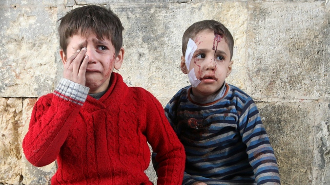 Injured boys react at a field hospital after airstrikes on the rebel held areas of Aleppo, Syria November 18, 2016. REUTERS/Abdalrhman Ismail TPX IMAGES OF THE DAY ATTENTION EDITORS - VISUAL COVERAGE OF SCENES OF INJURY OR DEATH - RTX2UA0I